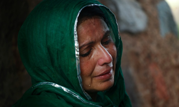 A devout Muslim woman cries as she offers prayers at an ancient mosque, now partly in ruins, before breaking her fast in New Delhi, India, Friday, Aug. 2, 2013. Muslims across the world refrain from eating, drinking and smoking from dawn to dusk during the Islamic holy month of Ramadan. (AP Photo/Saurabh Das)