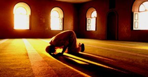 Muslim man prays in mosque