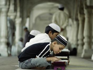 Little-boy-is-reading-Quran